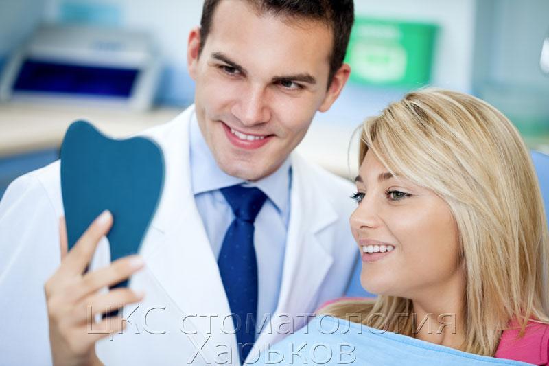 фото врач-ортодонт и пациентка