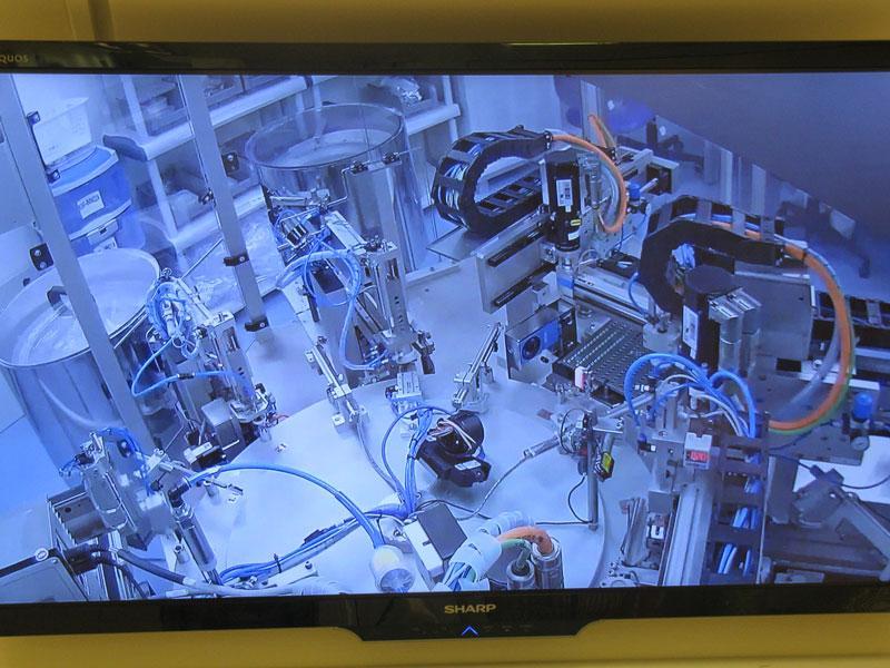 Механизированная линии упаковки имплантов фото